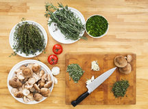Vegetables And Chopping Board On Kitchen Counter stock photo