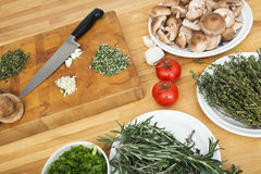 Vegetables With Chopping Board And Knife On Counter royalty free stock photos