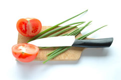 Vegetables on chopping board Stock Photos