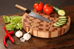 Vegetables on a chopping board Stock Photos