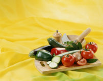 Vegetables on a chopping board and mortar Stock Photography