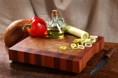 Vegetables on a chopping board Stock Photo
