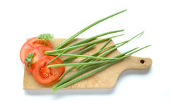 Vegetables on chopping board Stock Photo