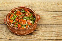 Vegetables in clay bowl Royalty Free Stock Images