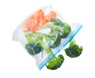 Vegetables in clear plastic bag. Isolated on white background Stock Image