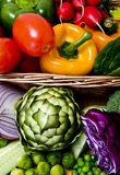 Vegetables close-up. Delicious fresh vegetables overflowing a basket Royalty Free Stock Image