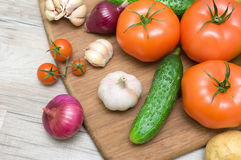 Vegetables closeup on wooden background Royalty Free Stock Image