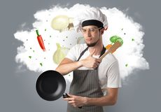 Vegetables on cloud with male cook. Drawn vegetables on cloud with male cook and kitchen tools royalty free stock photography
