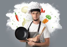 Vegetables on cloud with male cook. Drawn vegetables on cloud with male cook and kitchen tools royalty free stock photo