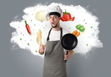 Vegetables on cloud with male cook. Drawn vegetables on cloud with male cook and kitchen tools royalty free stock image