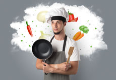 Vegetables on cloud with male cook Stock Photo