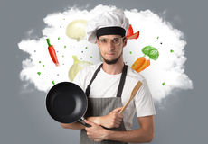 Vegetables on cloud with male cook Royalty Free Stock Photography