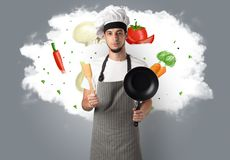 Vegetables on cloud with male cook. Drawn vegetables on cloud with male cook and kitchen tools royalty free stock images