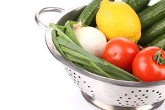 Vegetables in colander. Stock Photos
