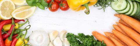 Vegetables collection tomatoes carrots cooking ingredients banne. R background top view from above Stock Photos