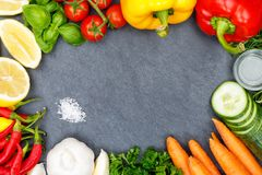 Vegetables collection tomatoes carrots cooking ingredients slate Stock Photography