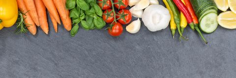 Vegetables collection tomatoes carrots cooking ingredients slate. Banner copyspace background top view from above Royalty Free Stock Images