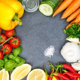 Vegetables collection tomatoes carrots cooking ingredients squar. E slate bell pepper background top view from above Royalty Free Stock Photography