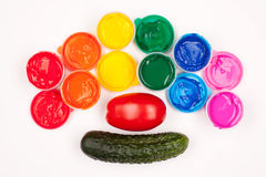 Vegetables and color paints Royalty Free Stock Image