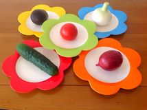 Vegetables on the colorful plates Stock Photo