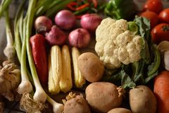 Vegetables composition on wooden background. With copy space Royalty Free Stock Images