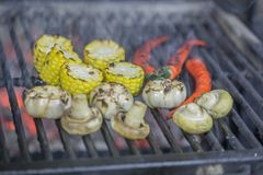 Vegetables are cooked in josper in the restaurant kitchen royalty free stock images