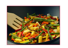 Vegetables cooked in a wok Royalty Free Stock Image