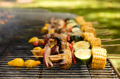Vegetables cooking on a barbeque grill Stock Images