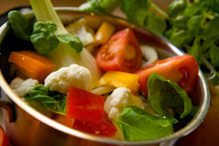 Vegetables in cooking pot. Closeup of colorful cut vegetables in a cooking pot stock image