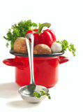 Vegetables in a cooking pot over white Stock Photo