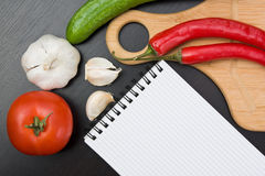 Vegetables and cooking utensils Stock Photography