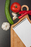 Vegetables and cooking utensils Royalty Free Stock Photos