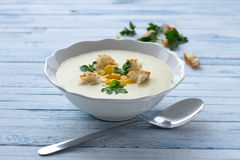 Vegetables cream soup with corn, croutons and parsley Stock Photo