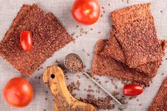 Vegetables crispbread crackers with flax seeds and tomatoes stock photo