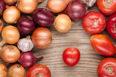 Vegetables crop background onions garlic tomatoes top view Stock Image