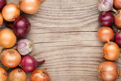 Vegetables crop  on wooden background onions garlic, top view, c Stock Images