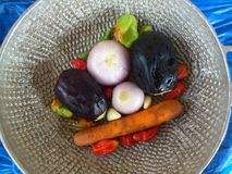 VEGETABLES AND CULINARY ART. This beautiful colorful decor includes onions, purple eggplant, peppers, garlic and carrote Royalty Free Stock Photo