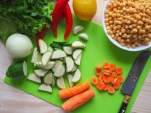 Vegetables cut. Chickpeas with zucchini. Vegetarian diet. Rustic useful kitchen. Vegetables cut. Chickpeas with zucchini. Vegetarian diet Stock Photography