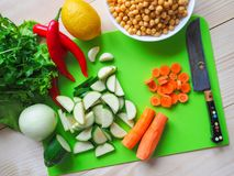 Vegetables cut. Chickpeas with zucchini. Vegetarian diet. Rustic useful kitchen. Vegetables cut. Chickpeas with zucchini. Vegetarian diet Royalty Free Stock Images