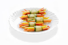Vegetables cut in straw wrapped in cucumber Royalty Free Stock Photos