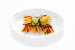 Vegetables cut in straw wrapped in cucumber Royalty Free Stock Photo