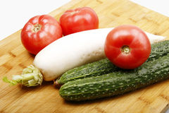 Vegetables on a cutting board Stock Photo