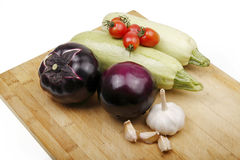 Vegetables on a cutting board. Some fresh vegetables on wooden cutting board royalty free stock photos