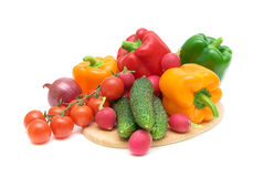 Vegetables on a cutting board close-up. Fresh vegetables on cutting board closeup on white background Royalty Free Stock Photo
