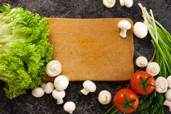 Vegetables on cutting board Stock Photography