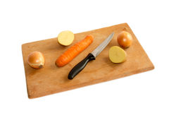 Vegetables on a cutting board. Isolated Stock Photo