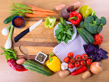 Vegetables on cutting board. Many different ripe vegetables on cutting board. large depth of field of the frame Royalty Free Stock Images