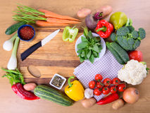 Vegetables on cutting board. Many different ripe vegetables on cutting board. large depth of field of the frame Royalty Free Stock Image