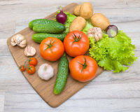 Vegetables on a cutting board on a wooden table closeup Royalty Free Stock Photography