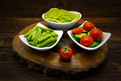 Vegetables on a dark wooden background Royalty Free Stock Images